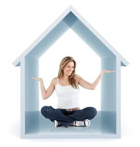 Beautiful woman smiling inside a 3d house isolated over a white background.jpeg